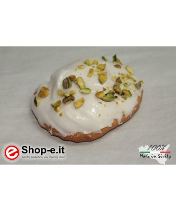 Buccellati with Sicilian almonds covered with icing and pistachio grains